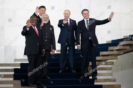 From left to right, South Africa's President Cyril Ramaphosa, China's President Xi Jinping, India's Prime Minister Narendra Modi, Russia's President Vladimir Putin and Brazil's President Jair Bolsonaro pose for a photo at the BRICS emerging economies at the Itamaraty palace in Brasilia, Brazil