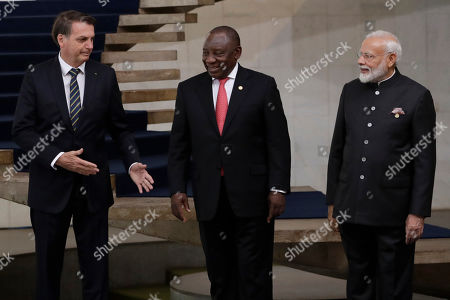 Jair Bolsonaro, Narendra Modi, Cyril Ramaphosa. Brazil's President Jair Bolsonaro, left, talks with South Africa's President Cyril Ramaphosa and India's Prime Minister Narendra, after the taking of the group photo of BRICS leaders on the second day of the summit, at the Itamaraty Palace in Brasilia, Brazil