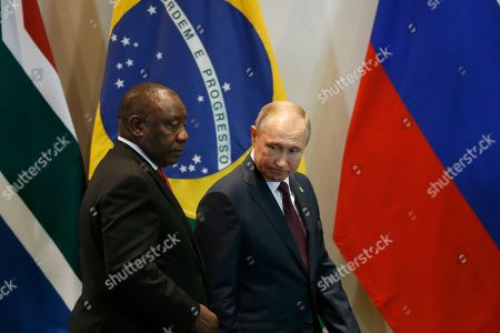 Vladimir Putin, Cyril Ramaphosa. South Africa's President Cyril Ramaphosa, left, and Russia's President Vladimir Putin, arrive for the Leaders Dialogue with BRICS Business Council and the New Development Bank, at the Itamaraty Palace in Brasilia, Brazil