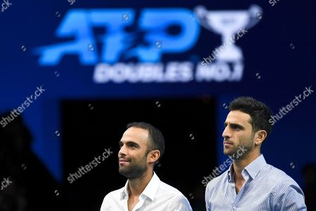Juan Sebastian Cabal, left, and Robert Farah of Colombia receive the award as World doubles No 1 during the ATP World Tour Finals at the O2 Arena in London