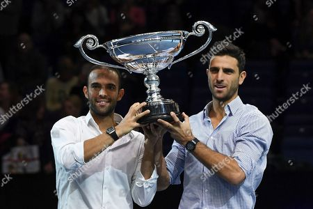 Juan Sebastian Cabal, left and Robert Farah of Colombia receive the award as World doubles No 1 during the ATP World Tour Finals at the O2 Arena in London