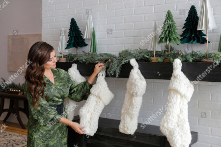 Tiffani Thiessen shows how she celebrates the holidays using new seasonal décor and crafts from JOANN Stores at a home on in New York. For Thiessen, holiday gifts and decorations are most special when she makes them herself, and she says JOANN is her one-stop destination to create a meaningful holiday