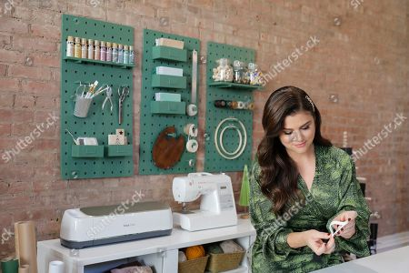Stock Picture of Tiffani Thiessen shows how she celebrates the holidays using new seasonal décor and crafts from JOANN Stores at a home on in New York. For Thiessen, holiday gifts and decorations are most special when she makes them herself, and she says JOANN is her one-stop destination to create a meaningful holiday