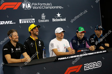 Drivers attends a press conference ahead of Sunday's Formula One Brazilian Grand Prix, at the Interlagos racetrack in Sao Paulo, Brazil, . From left to right, Haas driver Romain Grosjean, of France, Renault driver Daniel Ricciardo, of Australia, Mercedes driver Valtteri Bottas, of Finland, Racing Point driver Sergio Perez, of Mexico, Williams driver Robert Kubica, of Poland