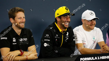From left, to right, Haas driver Romain Grosjean, of France, Renault driver Daniel Ricciardo, of Australia, and Mercedes driver Valtteri Bottas, of Finland, laugh during a press conference ahead of Sunday's Formula One Brazilian Grand Prix, at the Interlagos racetrack in Sao Paulo, Brazil
