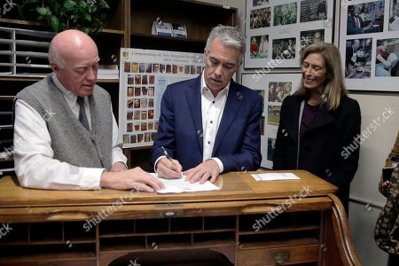 Joe Walsh, Bill Gardner, Helene Walsh. Republican presidential candidate former U.S. Rep. Joe Walsh, R-Ill., files to have his name listed on the New Hampshire primary ballot, in Concord, N.H. At left is New Hampshire Secretary of State Bill Gardner and at right is his wife Helene Walsh