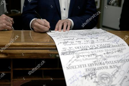Stock Picture of Republican presidential candidate former U.S. Rep. Joe Walsh, R-Ill., while filing his name to be listed on the New Hampshire primary ballot, signs a historical document that all the candidates from this primary sign with their name and campaign slogans, in Concord, N.H