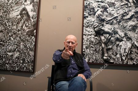 Stock Image of Brazilian photographer Sebastiao Salgado poses during an interview with Spanish international news agency Efe at the Tomas y Valiente Arts Center in Fuenlabrada, Spain, 14 November 2019, on occasion of the inauguration of his exhibit 'Gold. Tierra Pelada'. The exhibit runs from 14 November until 09 February 2020.