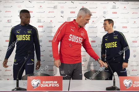 Switzerland's head coach Vladimir Petkovic (C) and players Denis Zakaria (L) and Stephan Lichtsteiner (R) attend a press conference in St. Gallen, Switzerland, 14 November 2019. Switzerland will face Georgia in their UEFA EURO 2020 qualifying soccer match on 15 November 2019.