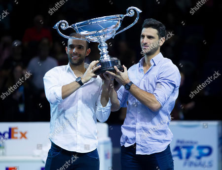 Colombians Juan Sebastian Cabal and Robert Farah were presented with the year-end doubles No. 1 trophy during the Nitto ATP Finals at the O2 Arena