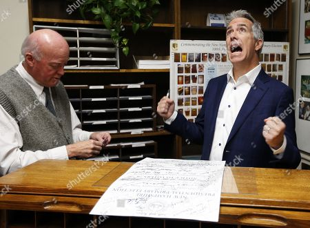 Stock Image of Republican candidate for United States President, former US Representative from Illinois Joe Walsh (R) reacts as he talks with New Hamsphire Secretary of State Bill Gardner (L) as files his paperwork to appear on the New Hamsphire Primary ballot at the New Hamsphire State House, in Concord, New Hampshire, USA, 14 November 2019. The first in the nation primary is scheduled to be held on 11 February 2020.