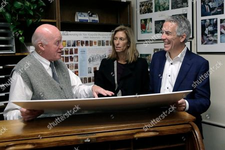 Republican presidential candidate former U.S. Rep. Joe Walsh, R-Ill., looks at a poster of the history of the New Hampshire primary with New Hampshire Secretary of State Bill Gardner, left, as he files to have his name listed on the New Hampshire primary ballot, in Concord, N.H. At center is his wife Helene Walsh
