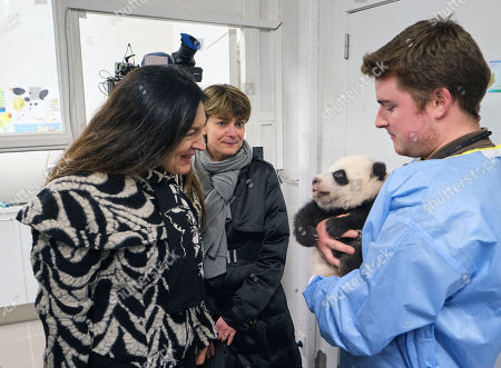 Minister Marie-Christine Marghem with one of the panda twins