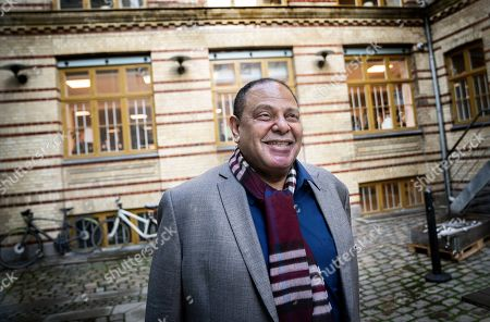 Stock Picture of Egyptian writer and a founding member of the political movement Kefaya, Alaa Al-Aswany poses during an interview on the release of his new book 'I ran to the Nile' in Copenhagen, Denmark, 14 November 2019.