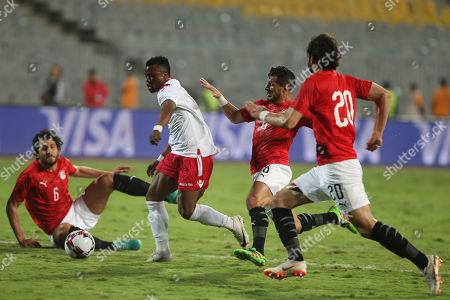 Kenya's Masika Ayubi  (m) in action against Egypt Player Tarek Hamed during the Africa Cup of Nations qualifications (AFCON 2021) match Egypt vs Kenya in Borg Al Arab stadium, Alexandria, Egypt, 14 November 2019.
