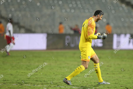 Egypt's Goal Keeper Mohamed Al Shenawi celebrates after his teammate Mahmoud Kahraba scoerd first goal against Kenya during the Africa Cup of Nations qualifications (AFCON 2021) match Egypt vs Kenya in Borg Al Arab stadium, Alexandria, Egypt, 14 November 2019.