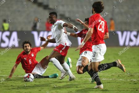 Kenya's Masika Ayubi  (C) in action against Egypt Player Tarek Hamed during the Africa Cup of Nations qualifications (AFCON 2021) match Egypt vs Kenya in Borg Al Arab stadium, Alexandria, Egypt, 14 November 2019.