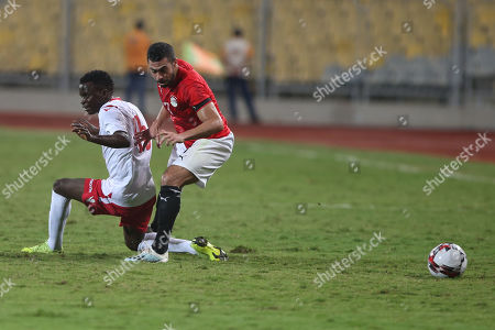Egypt's Ahmed Fathi (r) in action against Kenya Player Mandere Cliff during the Africa Cup of Nations qualifications (AFCON 2021) match Egypt vs Kenya in Borg Al Arab stadium, Alexandria, Egypt, 14 November 2019.