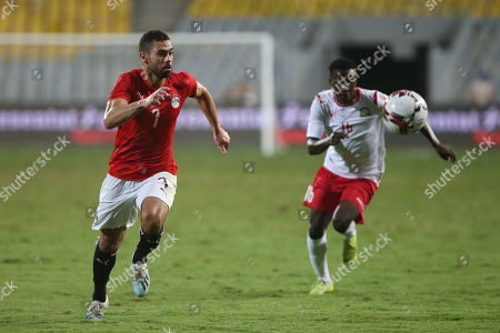 Egypt's Ahmed Fathi (L) in action against Kenya Player Mandere Cliff during the Africa Cup of Nations qualifications (AFCON 2021) match Egypt vs Kenya in Borg Al Arab stadium, Alexandria, Egypt, 14 November 2019.