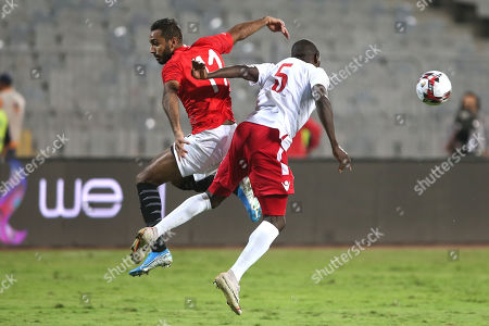 Egypt 's Mahmoud Kahraba (l ) in action against Egypt  Player Joash Achieng (r)  during the Africa Cup of Nations qualifications (AFCON 2021) match Egypt vs Kenya in Borg Al Arab stadium, Alexandria, Egypt, 14 November 2019.
