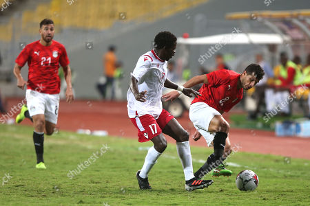 Egypt's Tarek Hamed (R) in action against Kenya Player Lawrence Ochieng during the Africa Cup of Nations qualifications (AFCON 2021) match Egypt vs Kenya in Borg Al Arab stadium, Alexandria, Egypt, 14 November 2019.