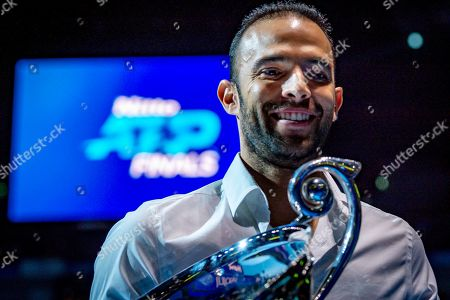 Juan Sebastian Cabal of Columbia walks off court holding the ATP Doubles No 1 trophy during the Nitto ATP Finals at the O2 Arena, London