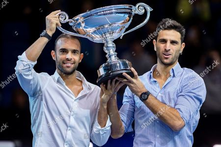 Juan Sebastian Cabal of Columbia (left) and Robert Farah of Columbia celebrate with their trophy becoming ATP Doubles No 1during the Nitto ATP Finals at the O2 Arena, London