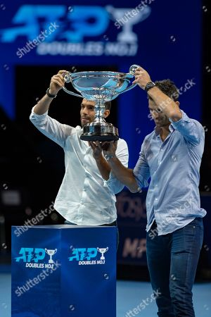 Juan Sebastian Cabal of Columbia (left) and Robert Farah of Columbia celebrate with their trophy becoming ATP Doubles No 1 during the Nitto ATP Finals at the O2 Arena, London