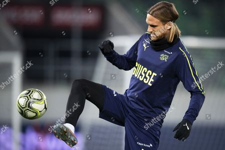 Switzerland's Michael Lang performs during his team's training session in St. Gallen, Switzerland, 14 November 2019. Switzerland will face Georgia in their UEFA EURO 2020 qualifying soccer match on 15 November 2019.