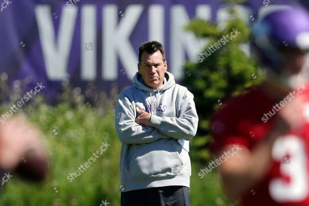 Minnesota Vikings assistant head coach and offensive advisor Gary Kubiak watches quarterbacks during drills at the team's NFL football training facility in Eagan, Minn. Kubiak's addition to the Minnesota Vikings coaching staff as a senior adviser has made a clear positive impact. This week, the Vikings host his long-time employer, the Denver Broncos, the team he served as head coach for in the 2015-16 seasons