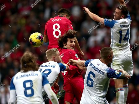 Stock Picture of Turkey's Caglar Soyuncu (C) in action against Iceland's Hordur Magnusson (C-L) and Ragnar Sigurdsson (C-R) during the UEFA Euro 2020 qualifier Group H soccer match between Turkey and Iceland in Istanbul, Turkey, 14 November 2019.