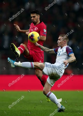 Turkey's Zeki Celik (L) in action against Iceland's Ari Skulason (R) during the UEFA Euro 2020 qualifier Group H soccer match between Turkey and Iceland in Istanbul, Turkey, 14 November 2019.