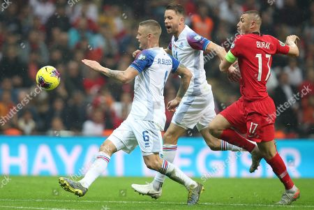 Turkey's Burak Yilmaz (R) in action against Iceland's Kari Amason (C) and Ragnar Sigurdsson (L) during the UEFA Euro 2020 qualifier Group H soccer match between Turkey and Iceland in Istanbul, Turkey, 14 November 2019