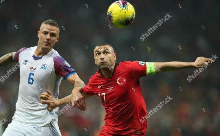 Stock Image of Turkey's Burak Yilmaz (R) in action against Iceland's Ragnar Sigurdsson (L) during the UEFA Euro 2020 qualifier Group H soccer match between Turkey and Iceland in Istanbul, Turkey, 14 November 2019