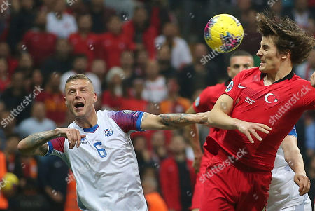 Caglar Soyuncu, Ragnar Sigurdsson. Turkey's Caglar Soyuncu, right, challenges for the ball with Iceland's Ragnar Sigurdsson, left, during the Euro 2020 Group H qualifying soccer match between Turkey and Iceland in Istanbul
