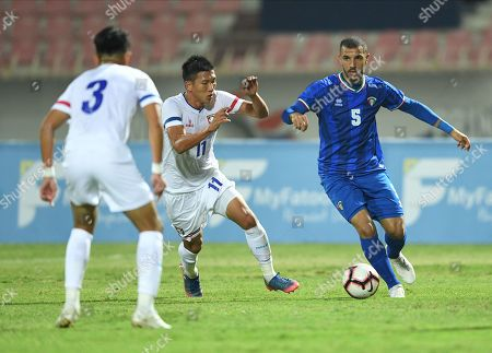 Stock Picture of Fahad Al Hajeri (R) of Kuwait in action against Wu Chun (C) of Taiwan during the Asian Qualifiers for the FIFA World Cup Qatar 2022 and AFC Asian Cup China 2023 Soccer match between Kuwait and Taiwan at Al kuwait club Stadium in kuwait city, kuwait, on 14 November 2019.