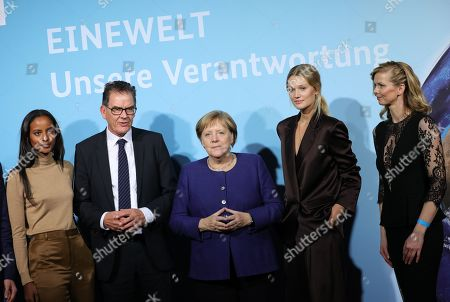 German Chancellor Angela Merkel (C) and the German Minister of Economic Cooperation and Development Gerd Mueller (2-L) pose for pictures with campaign ambassadors Sara Nuru (L), Toni Garrn (2-R) and Britta Steffens? (R) during the presentation of the UN Sustainable Development Goals (SDG) campaign, in Berlin, Germany, 14 November 2019. The SDG, organized by the Federal Ministry for Economic Cooperation and Development, is an agenda adopted by all United Nations Member States in 2015 aiming to end poverty, protect the planet and ensure that all people enjoy peace and prosperity by 2030.