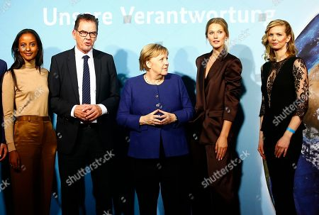 German Chancellor Angela Merkel (C) and the German Minister of Economic Cooperation and Development, Gerd Mueller (2-L) pose for pictures with campaign ambassadors Sara Nuru (L), Toni Garrn (2-R) and Britta Steffens? (R) during the presentation of the UN Sustainable Development Goals (SDG) campaign, in Berlin, Germany, 14 November 2019. The SDG, organized by the Federal Ministry for Economic Cooperation and Development, is an agenda adopted by all United Nations Member States in 2015 aiming to end poverty, protect the planet and ensure that all people enjoy peace and prosperity by 2030.