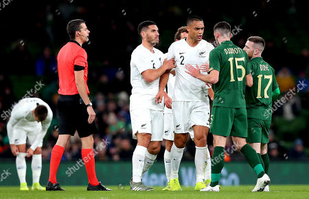Republic of Ireland vs New Zealand . Ireland's Troy Parrott and Winston Reid of New Zealand