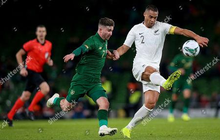 Republic of Ireland vs New Zealand. Ireland's Sean Maguire with Winston Reid of New Zealand