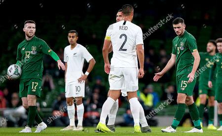 Republic of Ireland vs New Zealand. Ireland's Troy Parrott with Winston Reid of New Zealand