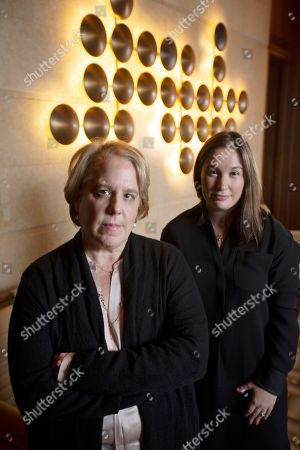 Roberta Kaplan, left, a lead lawyer in a lawsuit against white nationalists, and Amy Spitalnick, executive director of Integrity First for America, the nonprofit funding the case, pose in Atherton, Calif. The lawsuit was brought by a group of plaintiffs against individuals involved in planning a 2017 white nationalist rally in Charlottesville, Va., in which one counter-protester was killed and several others were injured