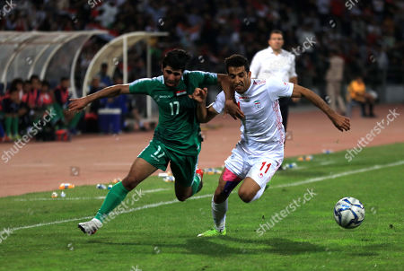 Iraq's Alaa Ali Mhawi (L) fights  for the ball with Iran's Vahid Amiri (R) during the FIFA World Cup 2022 group C qualifying soccer match between Iraq and Iran, in Amman, Jordan, 14 November 2019. The match was moved to Jordan due to the ongoing protests in Iraq.