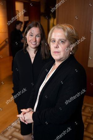 Roberta Kaplan, right, a lead lawyer in Sines v. Kessler, and Amy Spitalnick, executive director of Integrity First for America, the nonprofit funding the lawsuit, pose for a photo in Atherton Calif., . Sines v. Kessler was brought by a group of plaintiffs against white nationalists involved in planning a 2017 rally in Charlottesville, Va. in which one counter-protester was killed and several others were injured