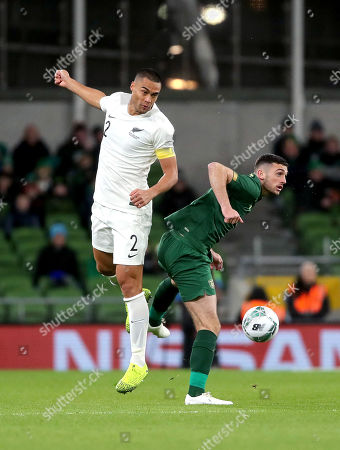 Republic of Ireland vs New Zealand. New Zealand's Winston Reid and Troy Parrott of Ireland