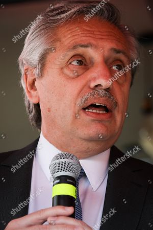Argentinian elect President Alberto Fernandez (R) and the candidate for president of Uruguay for the Frente Amplio, Daniel Martinez (Out of frame), speak to the press in a restaurant in Montevideo, Uruguay, 14 November 2019. Alberto Fernandez already visited Uruguay when he was still a presidential candidate and met with former President Jose Mujica (2010-2015), with whom he met again recently in Buenos Aires.