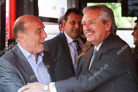 Argentinian elect President Alberto Fernandez (R) and the candidate for president of Uruguay for the Frente Amplio, Daniel Martinez (L), speak to the press in a restaurant in Montevideo, Uruguay, 14 November 2019. Alberto Fernandez already visited Uruguay when he was still a presidential candidate and met with former President Jose Mujica (2010-2015), with whom he met again recently in Buenos Aires.