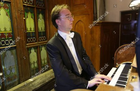 Stock Image of The organist Robert Kovac (Hungary) performs during a classical concert held in Damascus, Syria, 14 November 3019, in cooperation with the Higher Institute of Music and the Syrian National Symphony Orchestra. The concert is held as part of the weeklong Organ activities.In the Latin Church in Damascus.