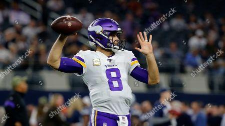 Minnesota Vikings' Kirk Cousins (8) throws a pass during an NFL football game against the Dallas Cowboys in Arlington, Texas