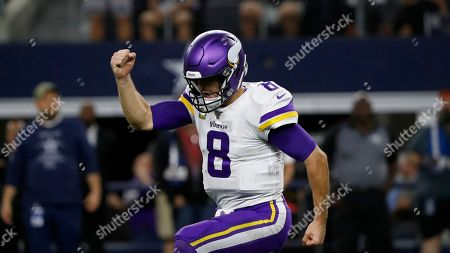 Minnesota Vikings quarterback Kirk Cousins (8) celebrates during an NFL football game against the Dallas Cowboys in Arlington, Texas